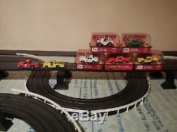 Life like slot car track With 2 Lifelike trucks Plus A Set Of 5 Dukes Of Hazzard