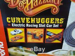NEW AUTO WORLD DUKES OF HAZZARD CURVEHUGGERS ELECTRIC SLOT CAR SET With EXTRAS